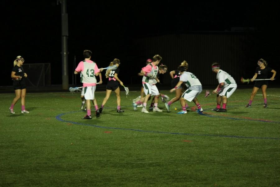 The Rocks lacrosse team played an exhibition match against Sacred Heart to raise money to fight breast cancer.