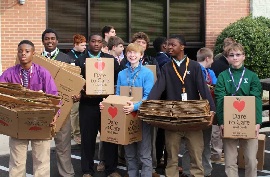 Some of Mr. Eddie Rudolph's students helped load the Dare to Care truck.  The Rocks donated boxes of food and more than $9,000.