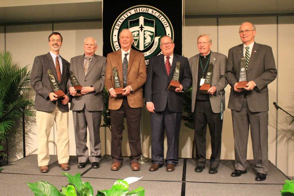 """The newest members of the Trinity Hall of Fame: Dr. John Belanger '78, Tony Zimlich (accepting the award for the late Rev. John Gephart), Richard """"Peewee"""" Carey, Bill Fuchs (accepting the award for the late Fred Fuchs '57), Rev. David Zettel '58 and Phil Stuecker '70."""