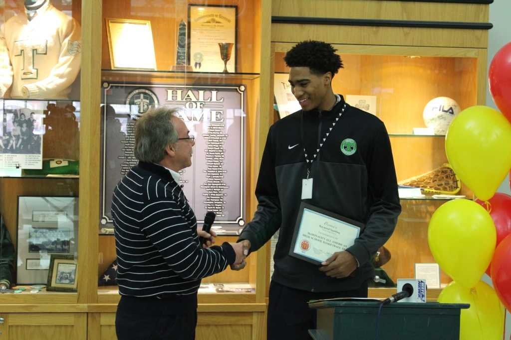 Local McDonald's owner/operator Perry Krause presented Trinity senior Raymond Spalding with a nomination to play in the annual McDonald's All-American Games.  Spalding was the only male basketball player from Kentucky to receive this honor.