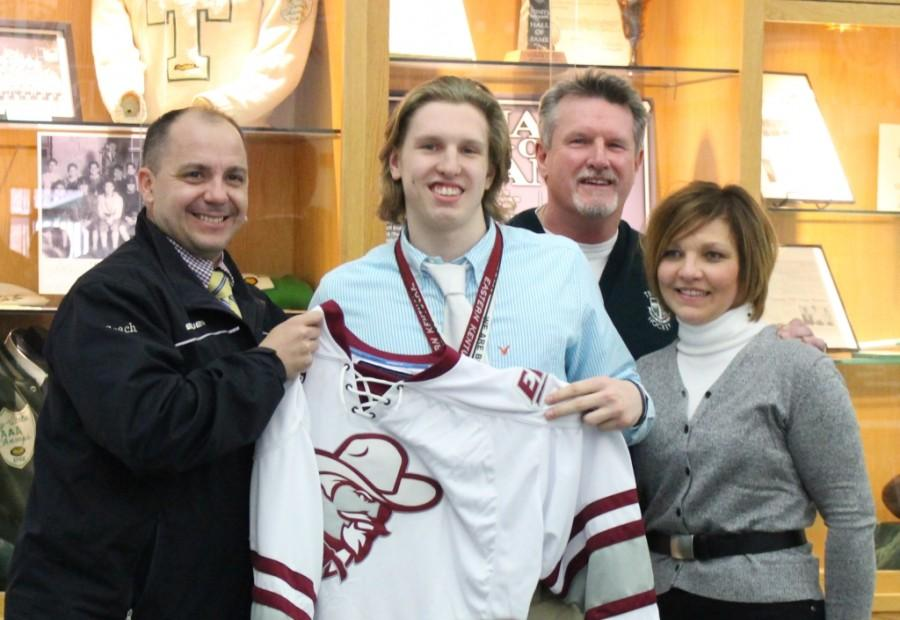 The signing ceremony was held in Trinity's Alumni Hall. Members of the Trinity coaching staff, Ryan's teammates and parents, Mark and Laura, were in attendance. Additionally, coach Joel Cormier, Eastern's ice hockey head coach, left, made the trip for the ceremony.