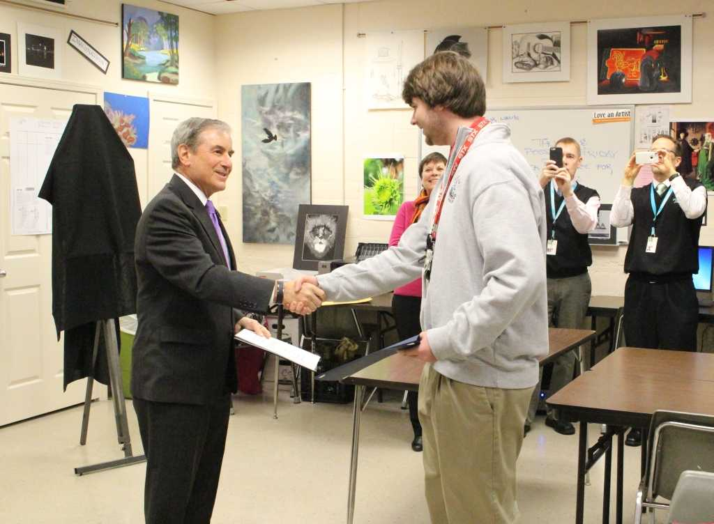 Congressman John Yarmuth congratulates senior Ben Kline on winning the 2015 Congressional Art Competition.