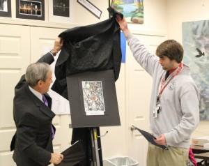 Congressman John Yarmuth and senior Ben Kline unveil Kline's winning photo.