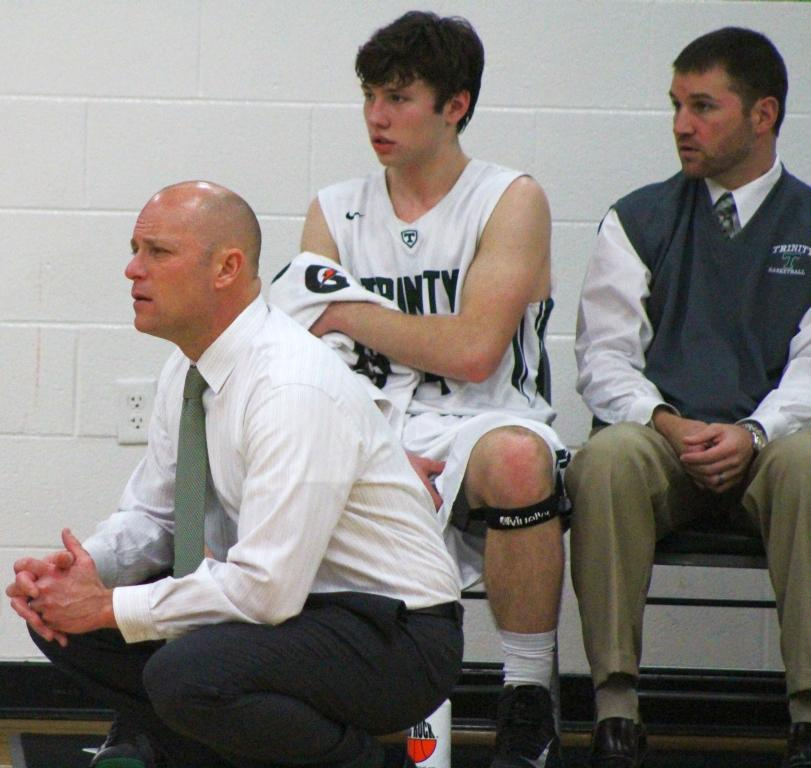 Trinity basketball head coach Mike Szabo, left, became the victory leader among all Trinity basketball coaches with win number 336 -- knocking off the E'town Panthers Feb. 9.