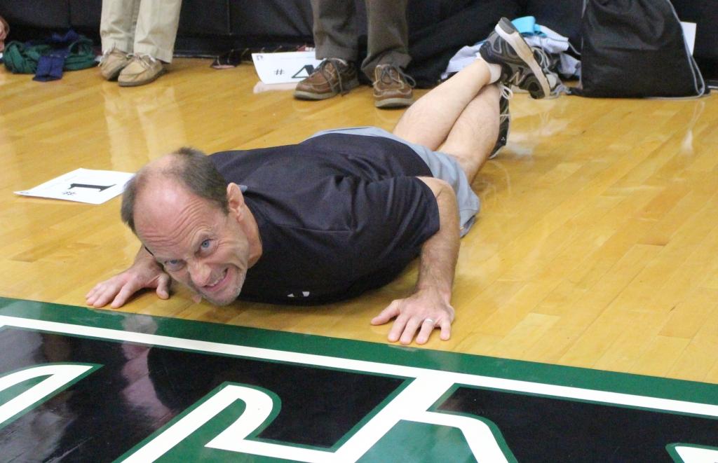 Mr. Michael Budniak puts his all into the pushups Principal's Challenge.