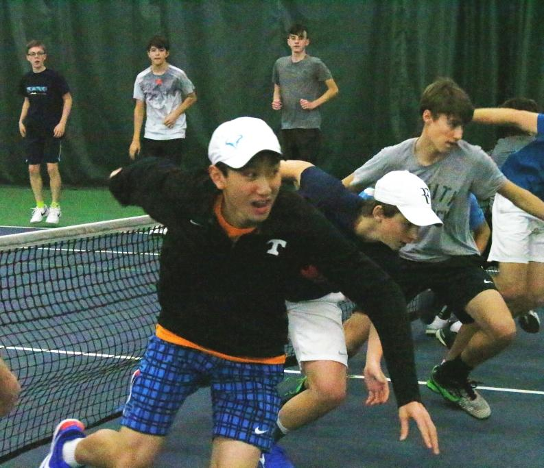 Trinity sophomore Brandon Chou and tennis teammates put in some drill time.