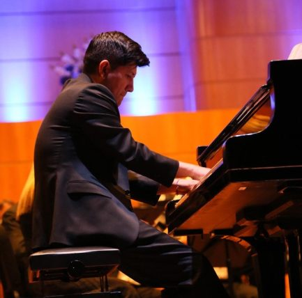 Trinity teacher Mr. Carlos Cuenca performing with the national symphony orchestra of Ecuador.