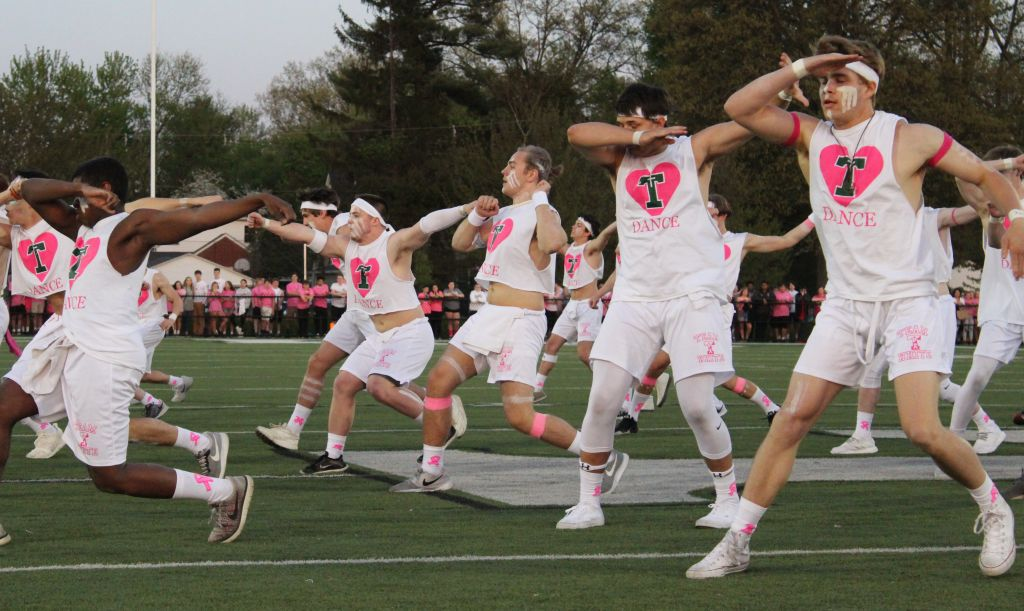 The Rocks performed at halftime of the Pink and White flag football game.