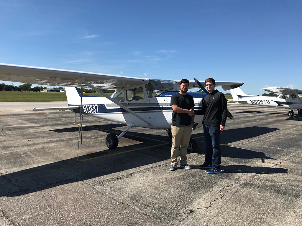 Flight instructor Eric Jameson and Trinity senior Jared Roberts