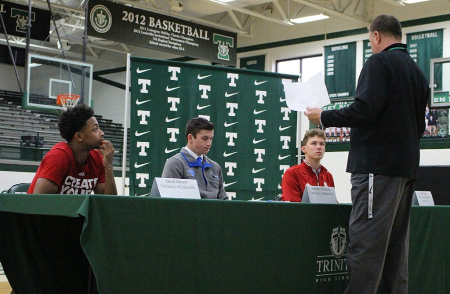 Trinity Athletics Director Rob Saxton talks with student-athletes David Johnson, Brandon McManus and Hunter Tapp, who signed letters of intent with UL, UK and NC State, respectively.