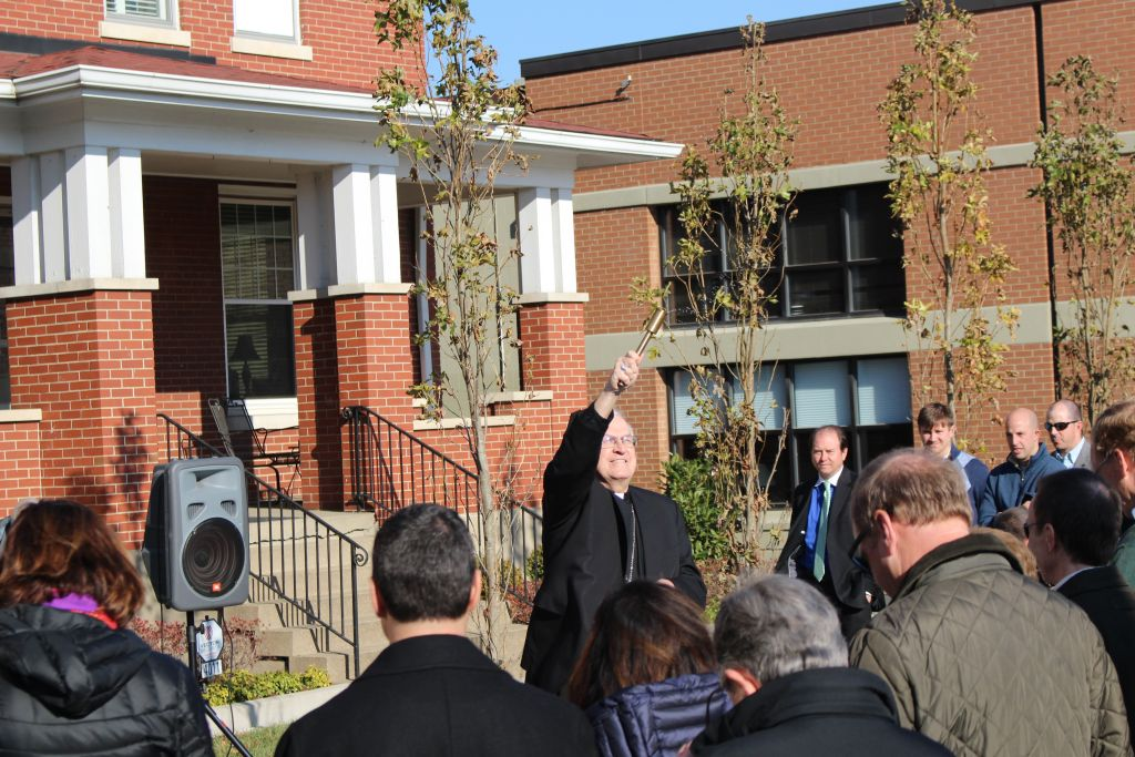 Archbishop Joseph Kurtz blesses the Hollenbach Family Alumni Courtyard.