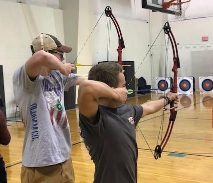 The Mercy-Trinity archery team, shown here at practice, has compiled impressive results.