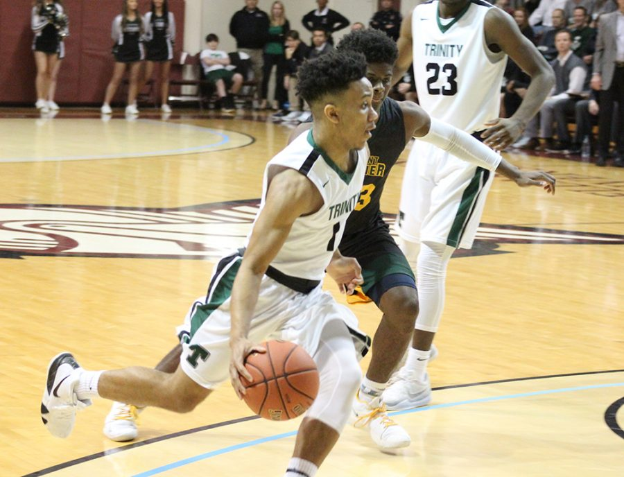 Senior Kolton Rice drives on a St. Xavier player in a 46-43 Rocks victory over the Tigers at Bellarmine University on Jan. 4.