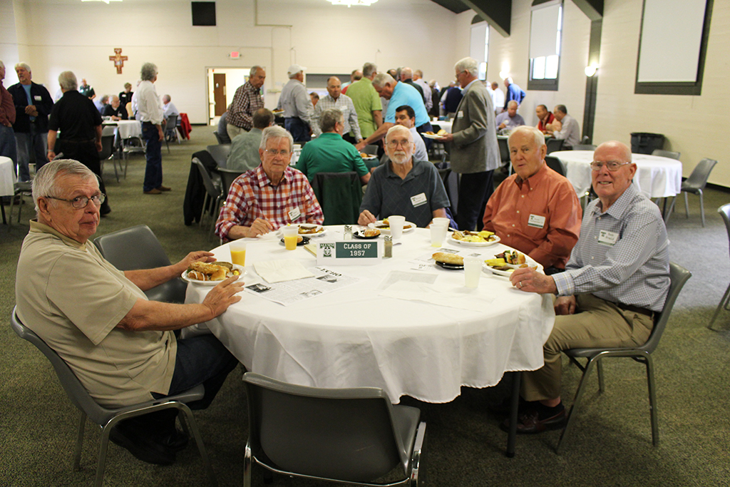 Graduates from 1957,  Trinity's first senior class, attended the annual Emerald Society Brunch.