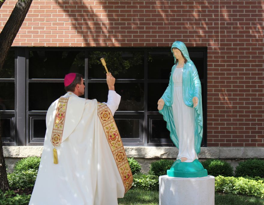 Bishop+Mark+Spalding+blessed+Trinity%27s+new+statue+of+Mary+on+Aug.+11.+