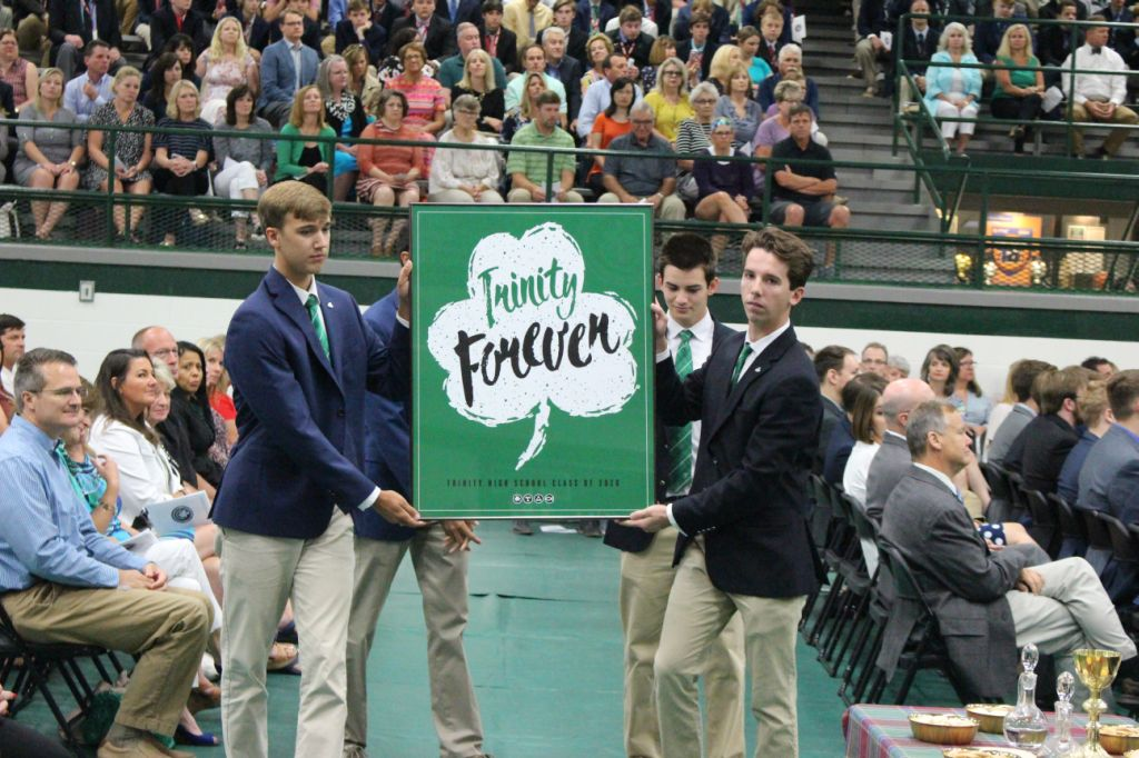 Senior Class officers displayed the year's theme poster during the annual Opening Mass.