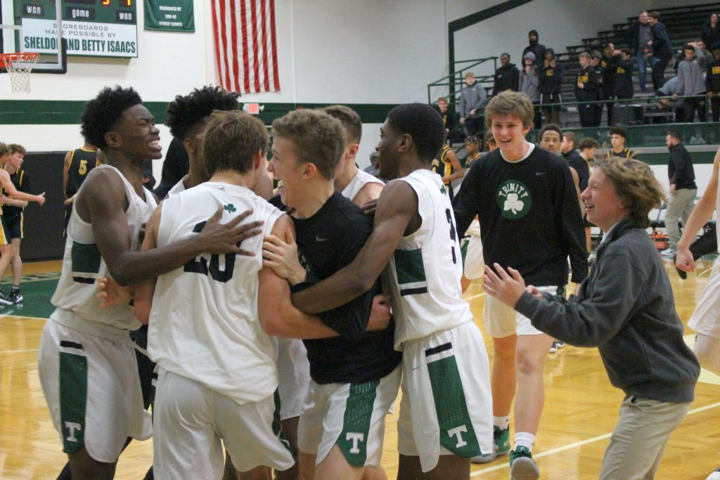 The Rocks celebrate after knocking off Centerville (Ohio) 47-46.