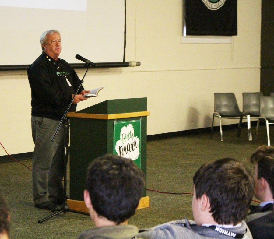 Teacher+Mr.+Mike+Domzalski+speaks+to+freshmen+about+Trinity%27s+mission.