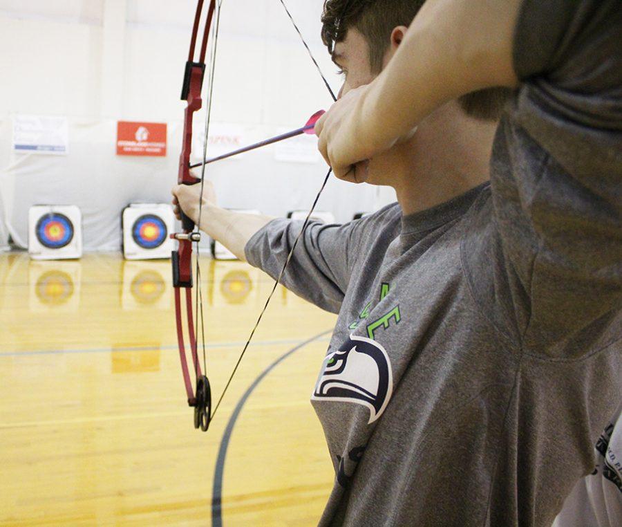 The+Trinity+archery+team+practices+at+Mercy+Academy.+