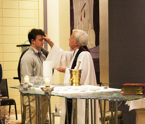 Senior Jackson Riney receives ashes from Trinity Chaplain Fr. Dave Zettel