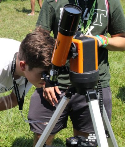 Scanning the heavens -- Trinity students gaze through a telescope during the Aug. 11, 2018, solar eclipse.