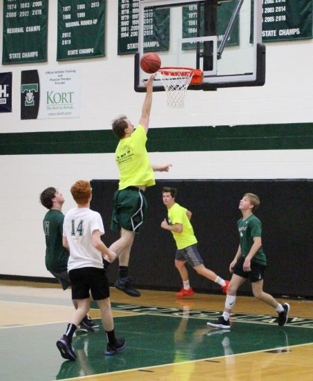 Mr. Bret Saxton soars to the rim during last year's 39-29 Old School faculty/staff team victory over the students.