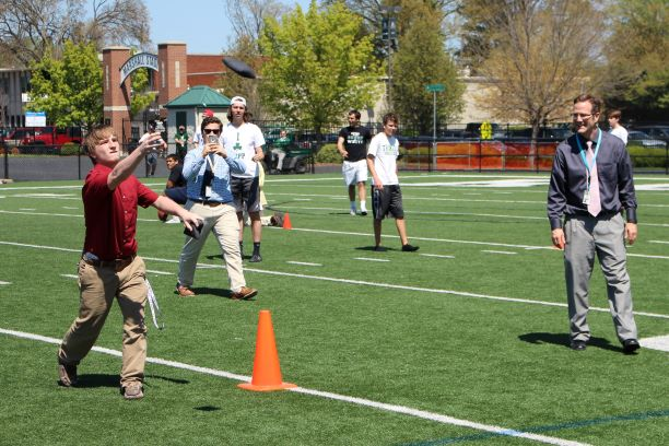 Trinity Principal Dr. Dan Zoeller helps out during a House Obstacle Course.