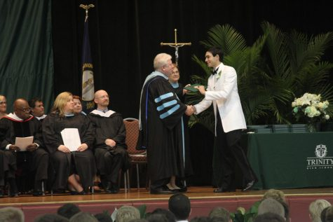 """For Trinity President Dr. Rob Mullen, the best moments come at graduation:  """"Handing out diplomas. I get to represent my colleagues and all those who have a hand in a graduate's journey. I know I am handing him the keys to his future. It is an honor to do so."""""""