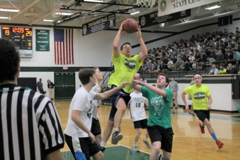Trinity teacher Mr. Josh Kusch drives to the basket during the 2019 annual Student-Faculty Basketball Game.