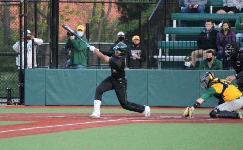 Trinitys Daylen Lile gets a hit against St. Xavier. The 33-2, No. 1-ranked Rocks prepare for postseason play.
