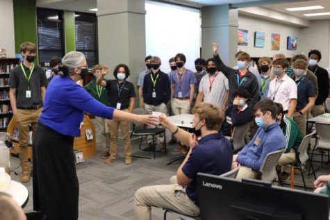 Sister Larraine Lauter offers cups of purified water to House advising group representatives.