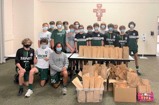 Trinitys JV soccer team assisted the Fed With Faith program.